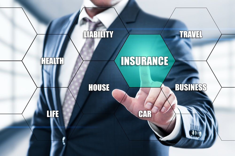 Insurance Life House Car Health Travel Business Health concept on the hexagons and transparent honeycomb structure presentation screen. Man pressing button on display with word in modern office